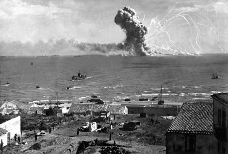 The U.S. Liberty ship Robert Rowan explodes after being hit by a German bomber off Gela, Sicily, 11 July 1943.