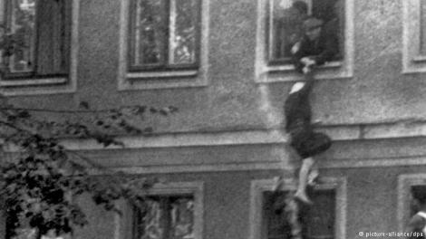 This famous photo from September 1961 shows a woman trying to escape East Berlin through an apartment block where one side of the building faced the West. Some men try to pull her back inside while others wait underneath, hoping to aid in her escape.