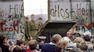 Amidst mounting internal and international pressure, a mistaken announcement by an East German official on November 9, 1989 led to the wall being opened. Germans on both sides of the border celebrated for days. New openings were made in the wall, like here at Potsdamer Platz two days later.