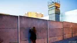 """A guard tower still marks the """"death strip"""" between layers of the former wall that divided Berlin."""