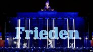 "The word ""peace"" was projected on to the Brandenburg Gate."