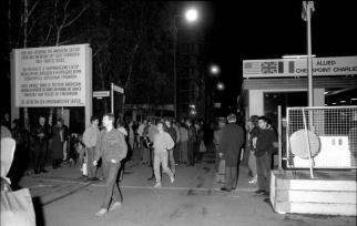Walking through Checkpoint Charlie, 10 November 1989.