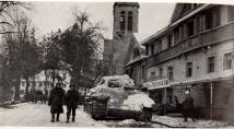 Hotel of the Ardennes, 1944 - U.S. soldiers posing in front of a German Panther