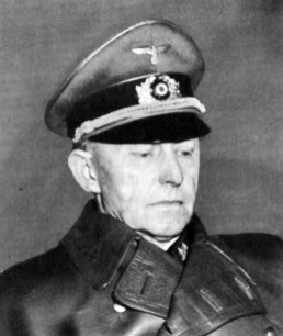 German general Alfred Jodl wearing black leather trenchcoat.