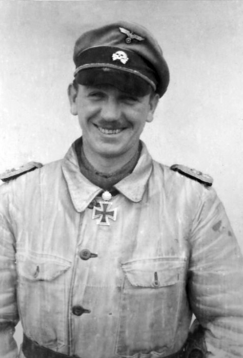 Kurt Meyer wearing fatigue uniform and crusher cap.
