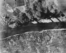 Aerial photo of the bombed out and on fire oil refinery in Hamburg, Germany 1944.