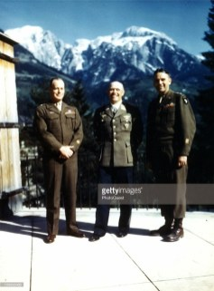 The day after his official surrender, German Generalfeldmarschall Albert Kesselring (center, Oberbefehlshaber Heeresgruppe Süd) poses with American Major General Maxwell D. Taylor (right, Commander of 101st Airborne Division) and Brigadier General Gerald J. Higgins (left, Assistant Commander 101st Airborne Division) at Berchtesgaden, Germany, May 10, 1945. Kesselring surrendered to an American major at Saalfelden, near Salzburg, in Austria on 9 May 1945. He was taken to see Major General Taylor, who treated him courteously, allowing him to keep his weapons and field marshal's baton, and to visit the Eastern Front headquarters of Heeresgruppe Mitte and Süd at Zeltweg and Graz unescorted! Taylor then arranged for Kesselring and his staff to move into a hotel at Berchtesgaden.