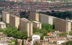 Even during World War II, the Nazi planners began to move around. Moderately so called for a departure from the medieval city centers which had dominated Germany for centuries. The results were not always pretty. Pictured here is Germany's first high-rise apartment complex, Hamburg's Grindelberg, built in 1957.