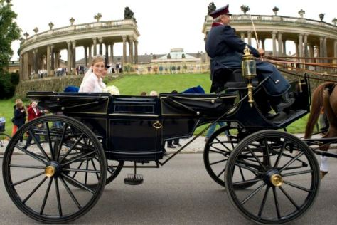 CORRECTS  RELATIONSHIP OF GEORG FRIEDRICH TO GREAT-GREAT-GRANDSON - Georg Friedrich Ferdinand Prince of Prussia , right, and  Princess Sophie  of Isenburg drive in a horse-drawn carriage in front of  Sanssouci  palace  after their wedding ceremony  in the church in Potsdam, Saturday Aug. 27, 2011. The Prince of Prussia is is the current head of the Imperial House of Hohenzollern, the former ruling dynasty of the German Empire and of the Kingdom of Prussia. He is the great-great-grandson and historic heir of Wilhelm II, the last German Emperor and King of Prussia, who was deposed and, initially, went into exile upon Germany's defeat in the Great War in 1918. ( AP Photo/dapd/ Klaus-Dietmar Gabbert)