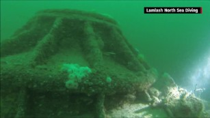It took four years to ID the submarine due to murky water conditions.