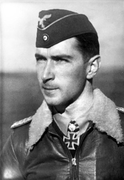 Werner Mölders wears an Officer's M35 Flying Cap (Fliegermütze), also called (side cap).