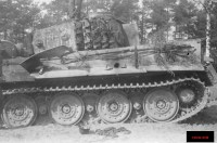 A German Tiger I knocked out near the River Aller in northern Germany in April 1945. One British round has clearly penetrated the side of the hull. An abandoned German helmet can be seen on the ground.