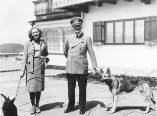 Braun with Hitler, walking their dogs.