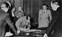 Schaub (on Hitler's left) at the signing of the Munich Agreement, 1938.