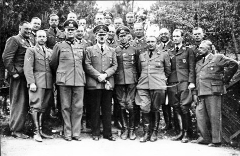Hitler with his staff at his Wolf's Lair field headquarters in May or June 1940.