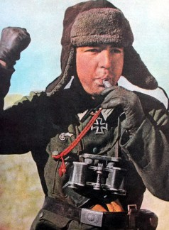 Ritterkreuzträger (Knight's Cross recipient) Oberleutnant Viktor Lindenmann (23 November 1916 - 9 September 1942) directing his bicycle troops using a whistle, somewhere on the Eastern Front, 1941-1942.