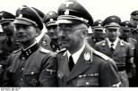 Otto Kumm (front row, left), Heinrich Himmler and other SS officers during a tour of Mauthausen-Gusen concentration camp, June 1941.