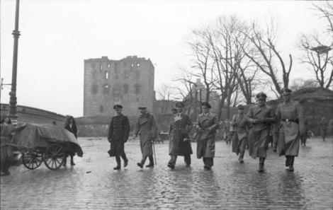 """German officers from Kriegsmarine , Deutsches Heer and Waffen SS on exploration in Bergen after the Explosion on the Libra on April 20, 1944 when the ammunition ship """"Vorboode"""" and parts of the city were blown up. Josef Terboven is number four from the left (with light fence). Besides, Admiral Otto von Schrader."""
