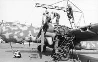 """A He 177 having an engine maintenance overhaul - note the second cylinder's exposed exhaust stub being even with the leading edge, an indication of the rearwards location of the """"power systems""""."""