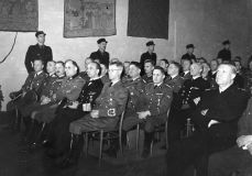 """Representatives of German dignity under the """" State Act in Akershus """" on February 1, 1942, when Quisling's """"national government"""" was instituted. Rikskommissar Terboven's assistant Wegener on the left of the first row with Terboven himself to the far right. Quisling , leads in National Collection (NS), mainly on the Norwegian side (right in the picture)."""