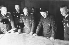 Keitel(far left) and other members of the German high command with Adolf Hitler (second from right) at a miltary briefing, (c. 1940).