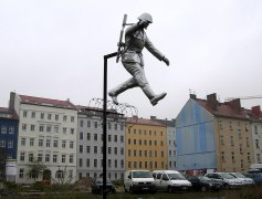 """Sculpture called Mauerspringer (""""Wall jumper"""") by Florian and Michael Brauer and Edward Anders."""