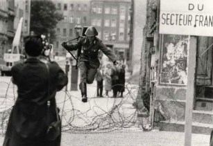 Conrad Schumann leaping over barbed wire into West Berlin on 15 August 1961.