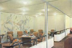 Lounge, with the world map painted on the wall.