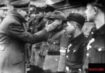 Adolf Hitler and Hitlerjugend Wilhelm Willi Hubner plus others in Hitler's last photo appearance in 1945 outside the Fuhrer-bunker.