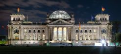 Reichstag building seen from the former Königsplatz at night.