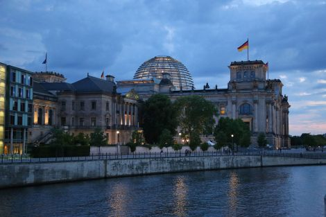 Rear of the Reichstag as seen at night from across the Spree.