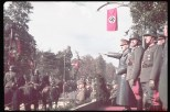 Hitler (L) viewing the victory parade in Warsaw after the German invasion of Poland.