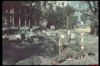 After German bombardment of Poland, citizens of Warsaw bury their dead in parks and streets.