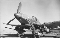 Hans-Ulrich Rudel's Junkers Ju 87G, with twin BK 3,7 gun pods attached to the underside of the wings, in Russia, being inertia-started using the hand-cranked flywheel.