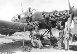 Junkers Jumo 211 inverted V12 powerplant on an aircraft undergoing repair, North Africa, 1941.