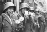 Volunteers of the Sudeten German Free Corps (German: Sudetendeutsches Freikorps) receiving refreshments from the local population in the city of Eger (Czech: Cheb).