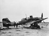 A Ju 87 B of 5/StG 2 is examined by British troops after making an emergency landing in the North African desert, December 1941.