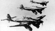 """Formation of Ju 87A dive-bombers, with the A's characteristic large wheel """"trousers"""", each having one transverse bracing strut."""