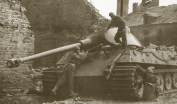 Knocked out Tiger 2 being inspected by allied soldiers.