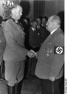 Walter Funk congratulates Franz Hayler , representative of the Reich Minister of Economics, for the award of the Knight's Cross of the Order of Merit.