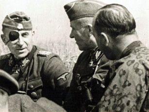 """SS Obergruppenfuhrer and General of the Waffen-SS Paul """"Papa"""" Hausser ( Commanding General II SS Panzer Corps ), SS-Oberführer Hermann Prieß (Commander SS-Panzergrenadier-Division """"Totenkopf"""" ) and SS-Obersturmbannführer Otto Baum (Commander SS- Panzergrenadier-Regiment """"Totenkopf""""), early summer 1943."""