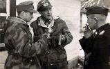 Colonel Friedrich-Carl von Steinkeller and Colonel Adalbert Schulz on the Eastern Front in conversation with a war correspondent , 8 December 1943.