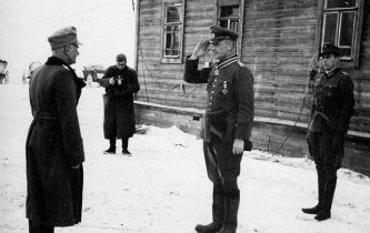 Knight's Crossing Ceremony for Lieutenant-General Völckers by General of Artillery Robert Martinek (left).