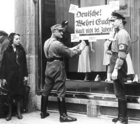 Members of the SA enforce the boycott of Jewish stores, 1 April 1933.