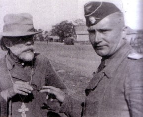 Kurt Eggers in conversation with an Orthodox priest in June 1943 on the Eastern Front.