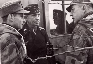 Colonel Schulz (center) in an intermission break on January 5, 1944 in conversation with Colonel Dr. Karl Mauss (right).