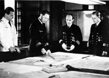 Rudolf Petersen (pointing) with Klaus Feldt and Niels Bätge (far right).