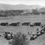 Vehicles of Prinz Eugen's 7th Panzer Battalion (including SOMUA S35 and Hotchkiss H39 tanks) laagering on the outskirts of a Bosnian town.