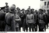 August Schmidhuber (far right, in front) and other SS officers on tour of Mauthausen-Gusen concentration camp, April 1941.