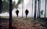 Finnish Infantry advancing to a new position through a smoke screen - possibly in a training.